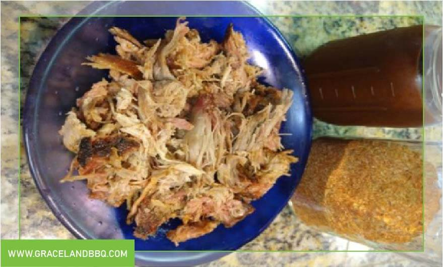 cooked Pulled pork with bbq sauce and rub