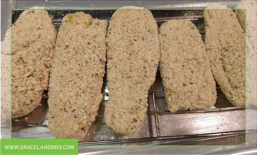 crumbed pickles on rack for Fried pickles